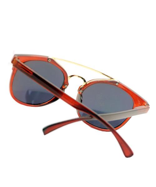 Oval womens sunglasses brown gold bridge.
