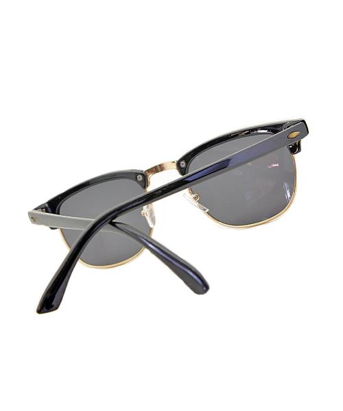 Gold rim black Clubmaster sunglasses.