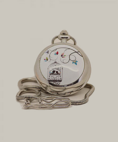 Big classic pocket watch with silver chain.