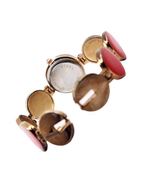 Round shape copper red stone bracelet watch.