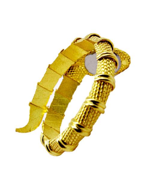 Serpentine diamond studded gold womans watch.