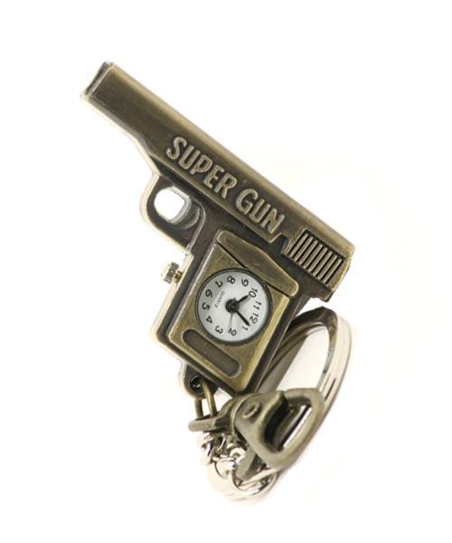 Bronze key chain quartz watch with clasp and gun pendant.