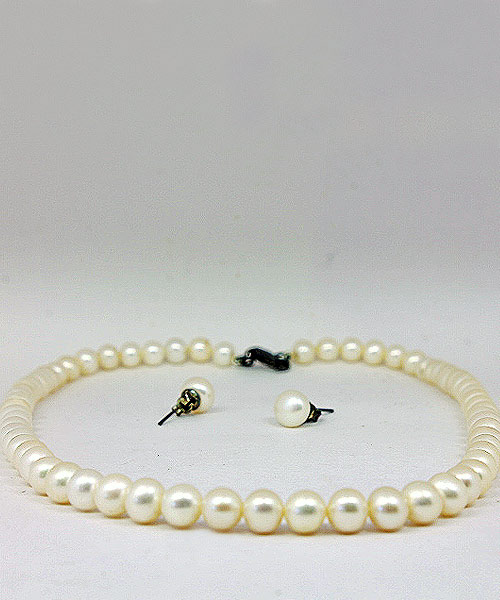 Faux pearl necklace stud earrings.
