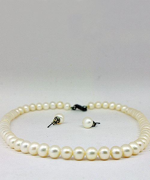 Faux pearl necklace stud earrings.