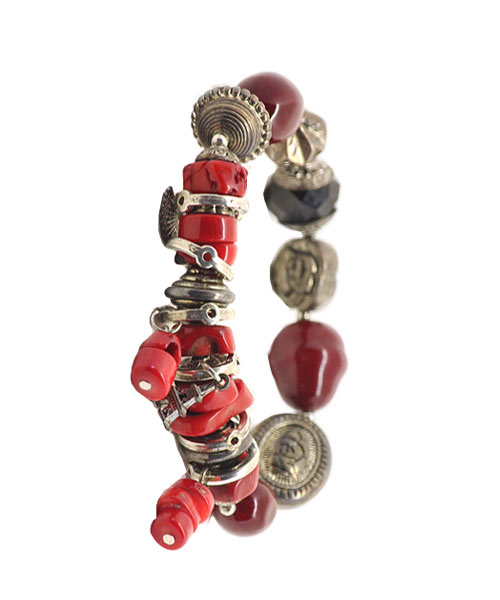 Girls bracelet with charms trinkets beads and stones.